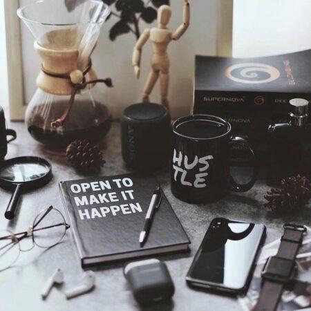 hustle black mug